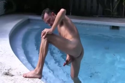 brunette hair man Strokes His large pecker In The Pool